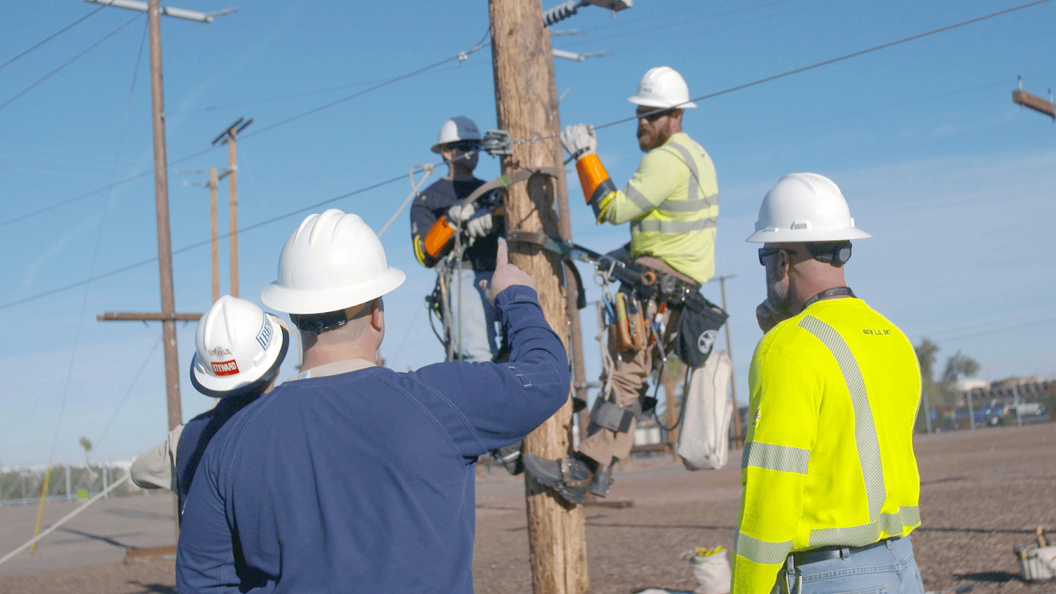 Men working on a power line.