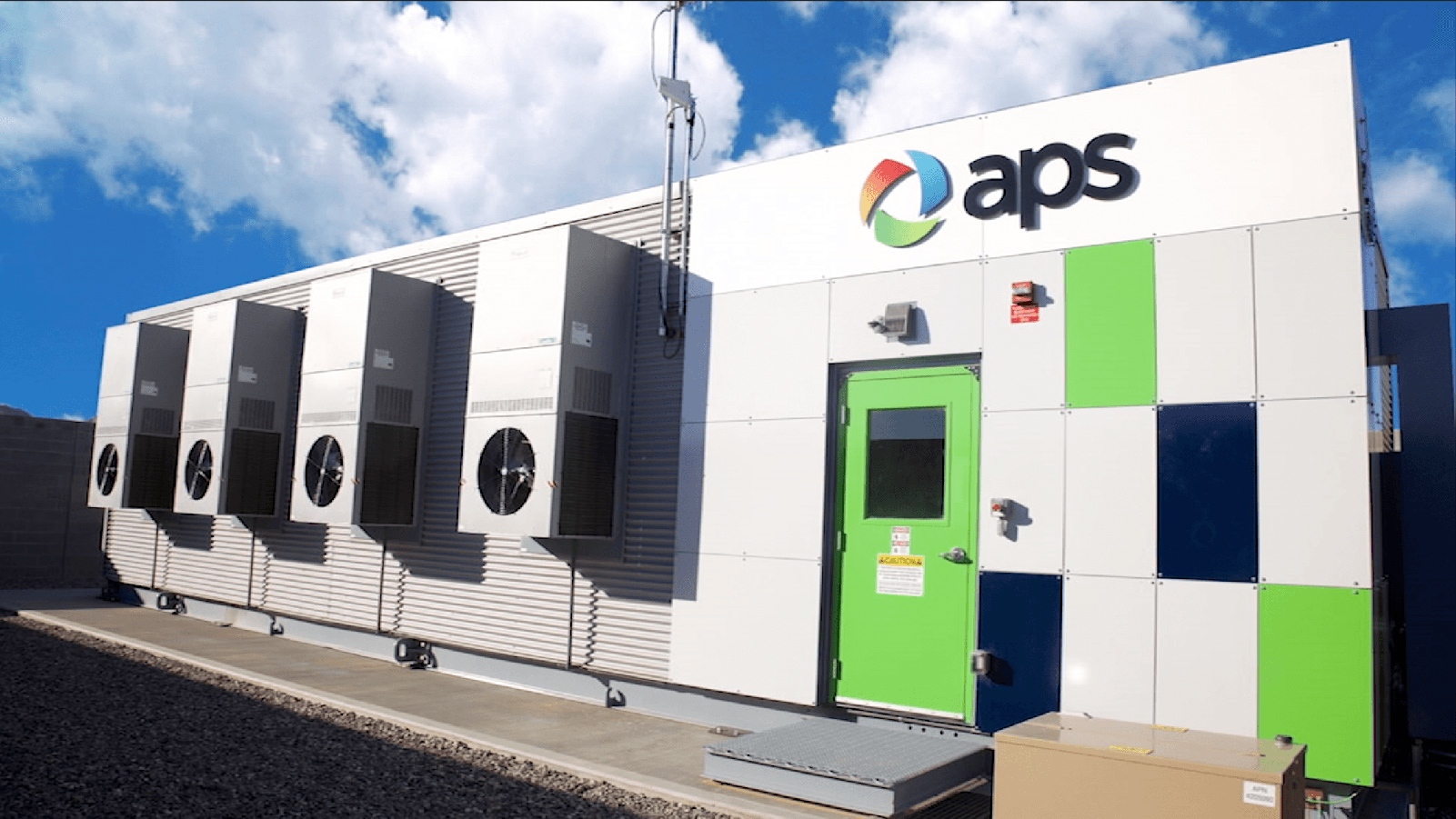 APS battery storage facility with a blue sky and clouds.