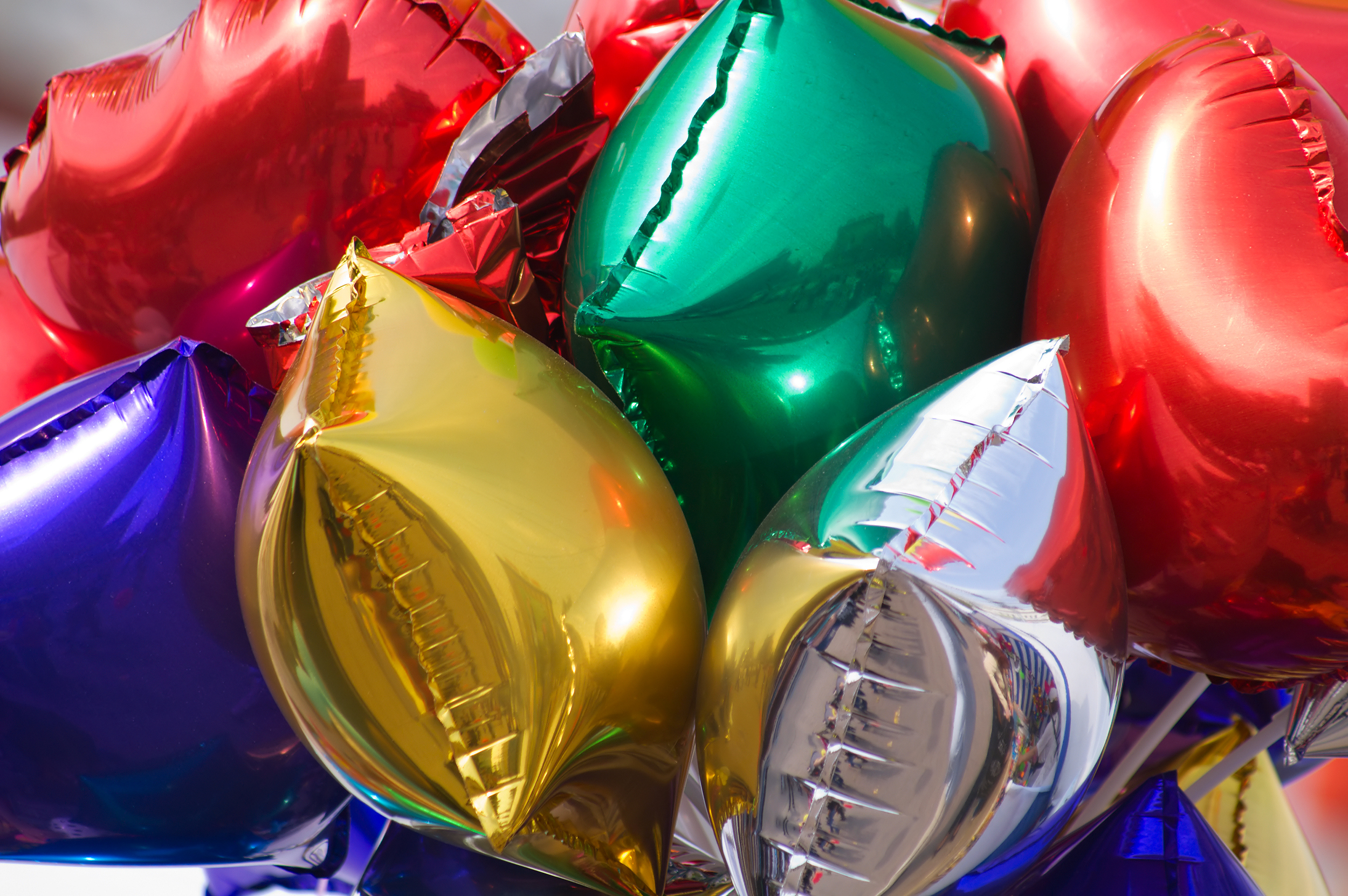 A bunch of colorful mylar balloons