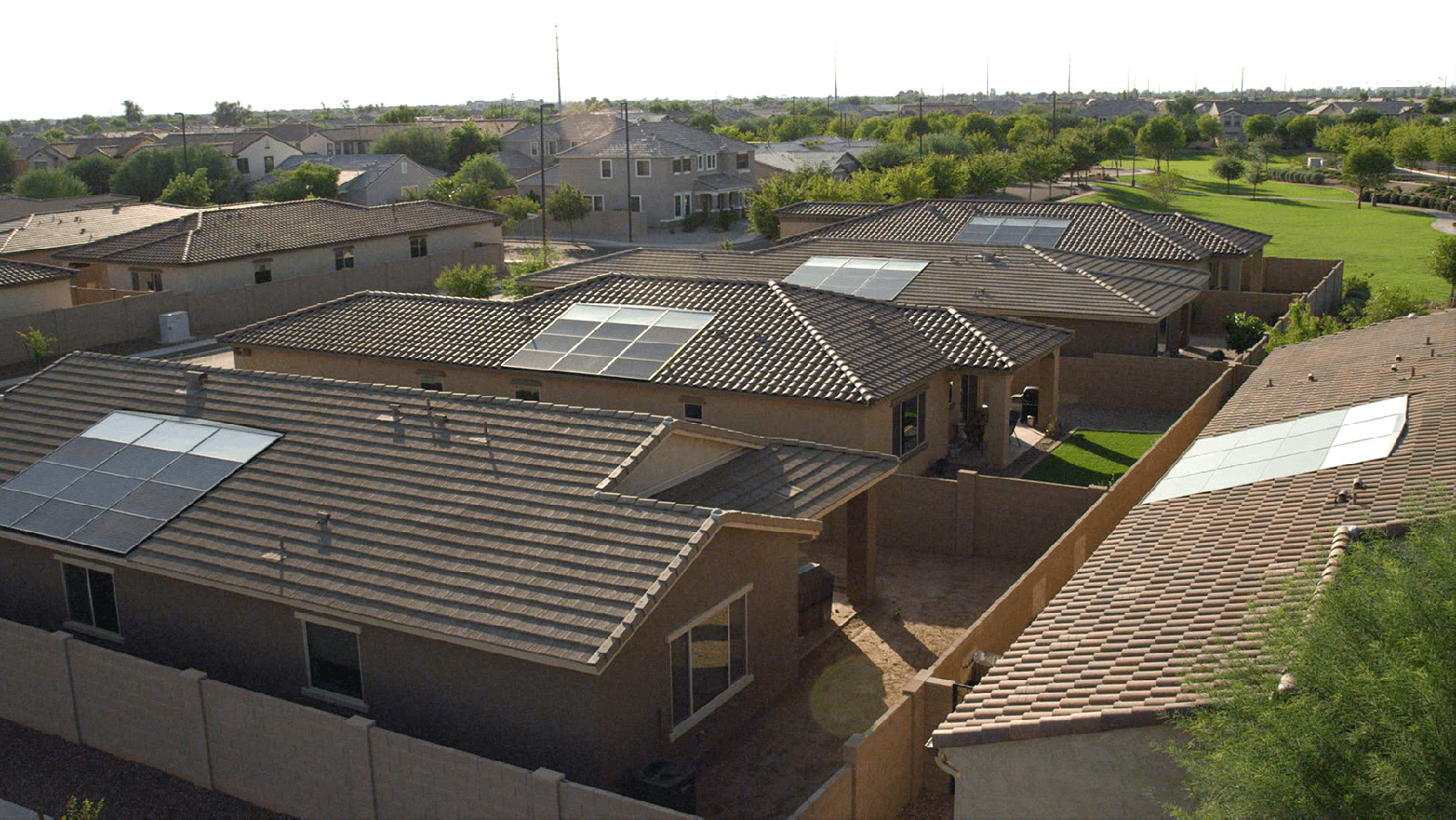 Residential homes with rooftop solar panels.