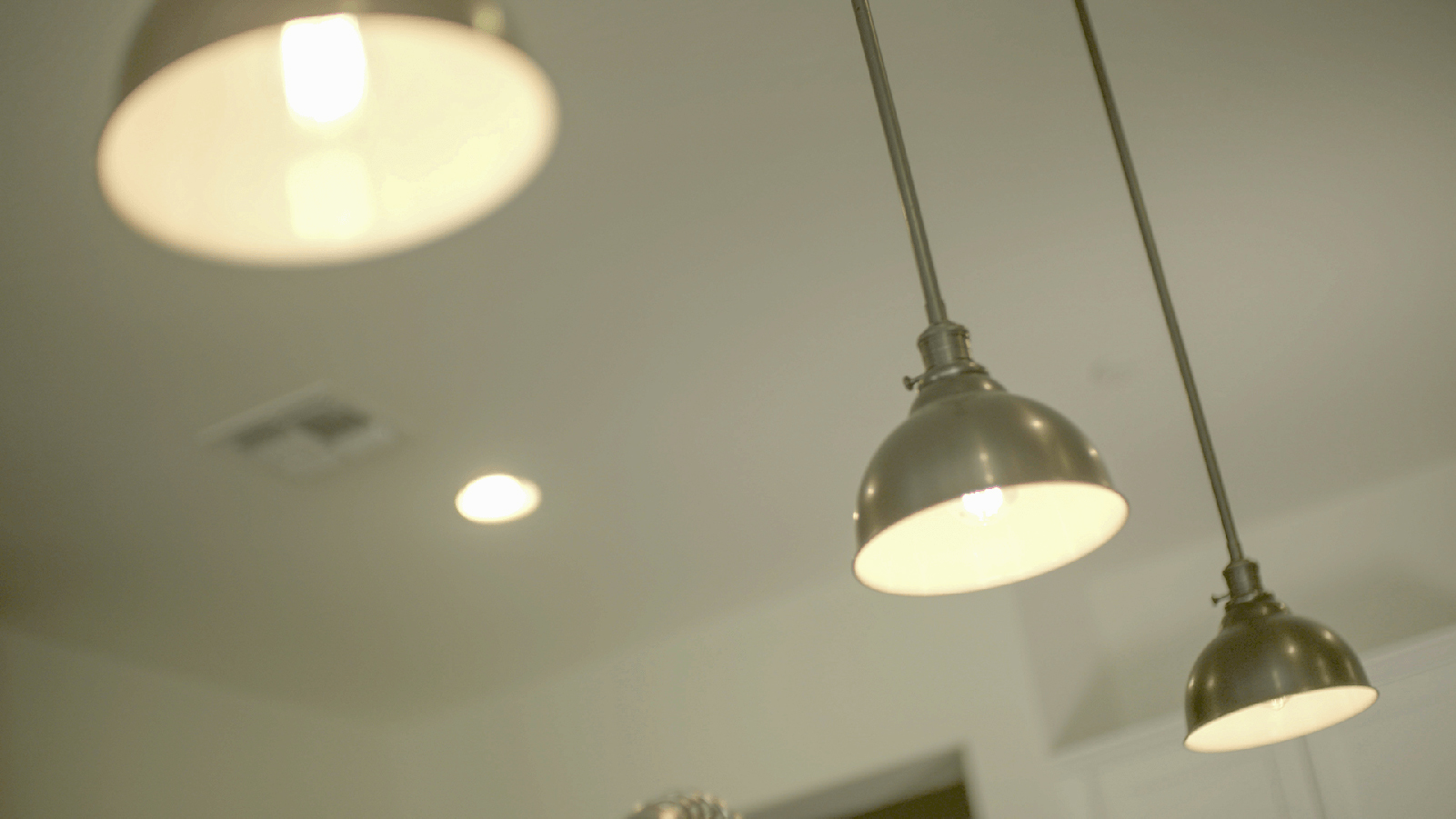 Light fixtures hanging from a ceiling.