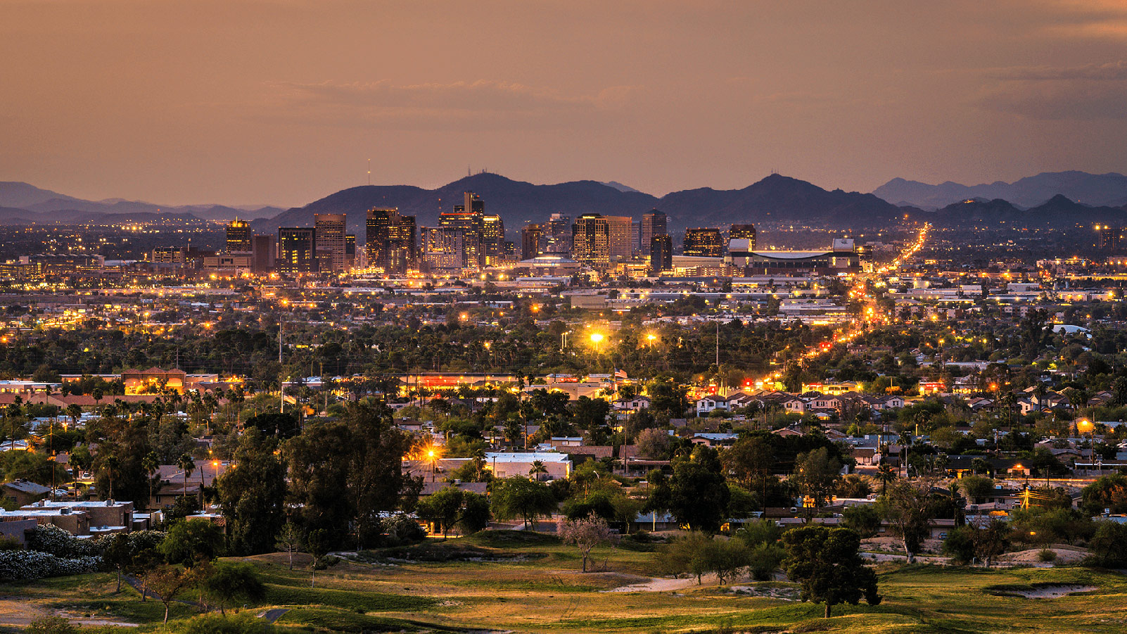 Phoenix metro area at dusk with greenery.