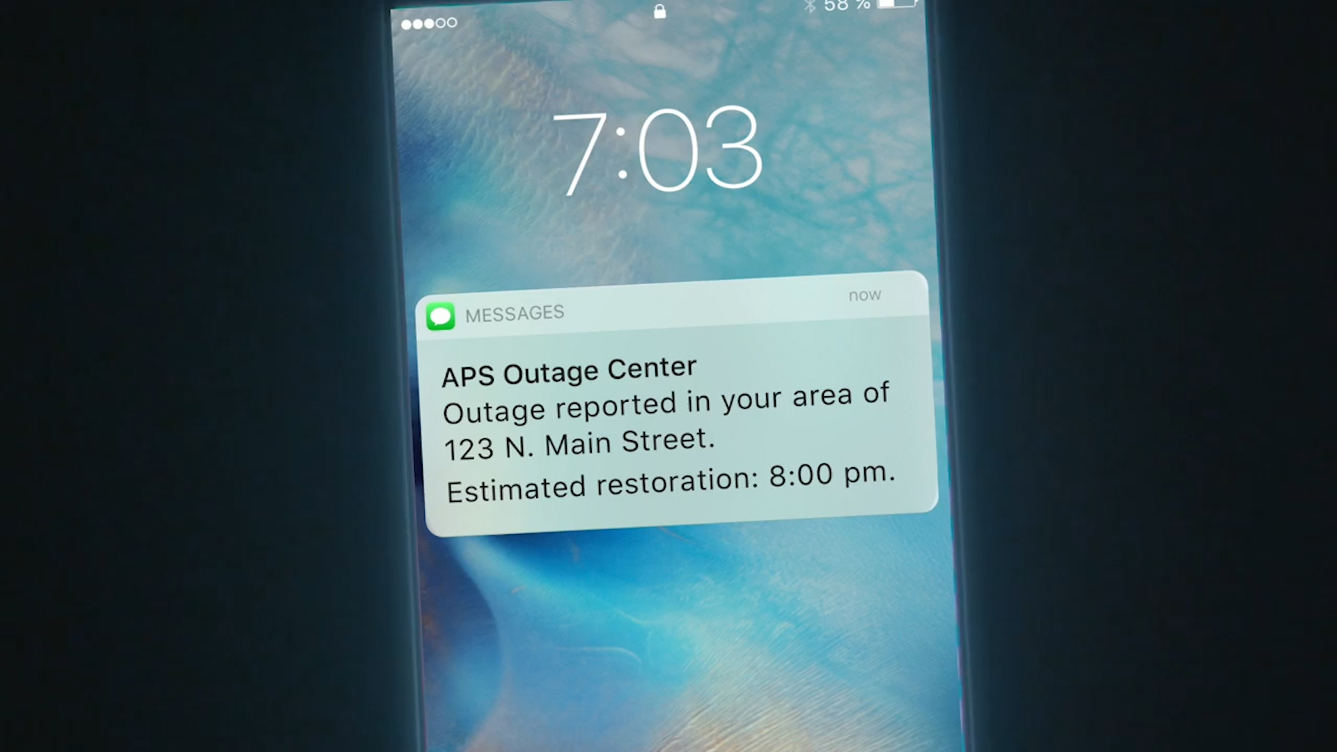 Close up view of an APS Outage Center notification on a phone.