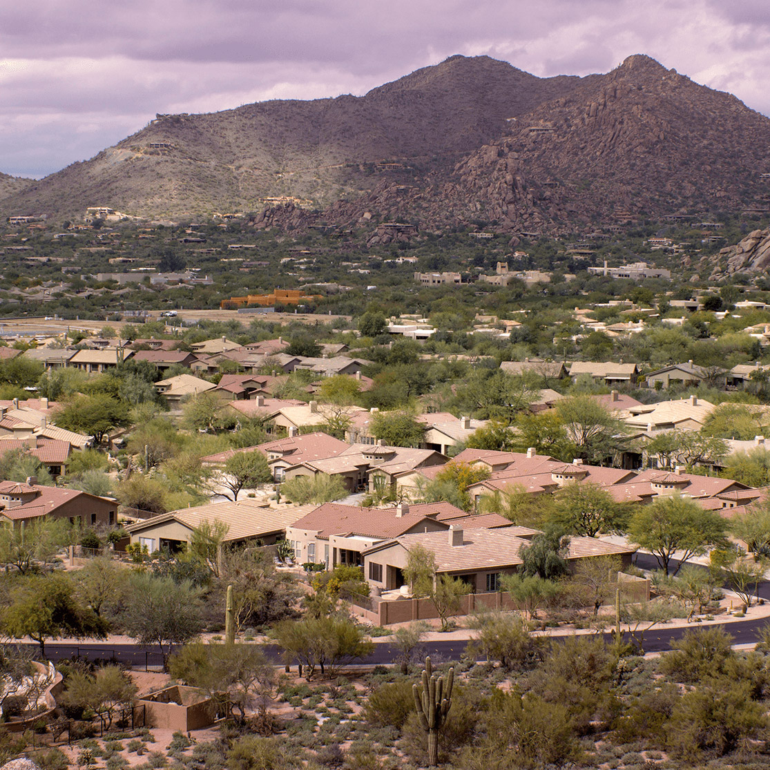 Phoenix valley homes with a mountain.