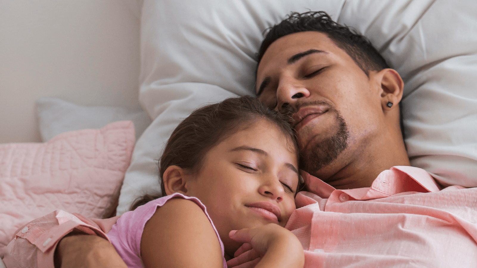 Father taking an afternoon nap with his daughter.