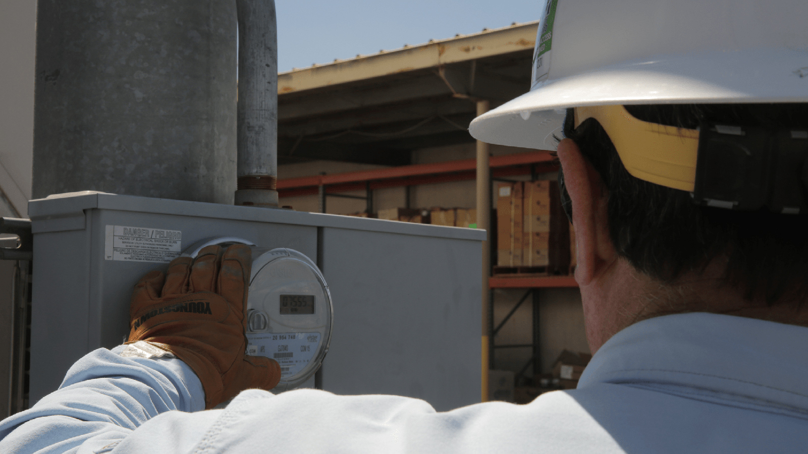 APS employee reading a meter.