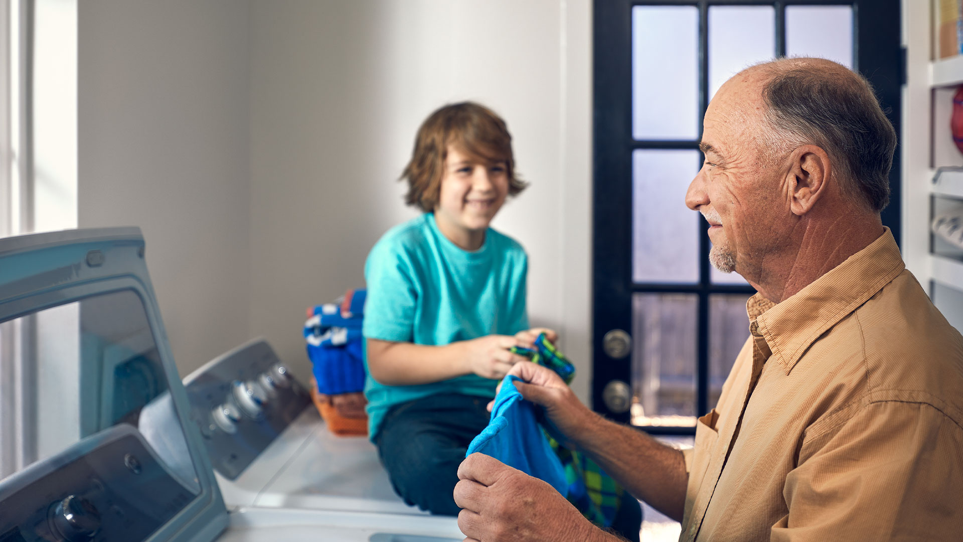 Grandpa and grandson doing laundry
